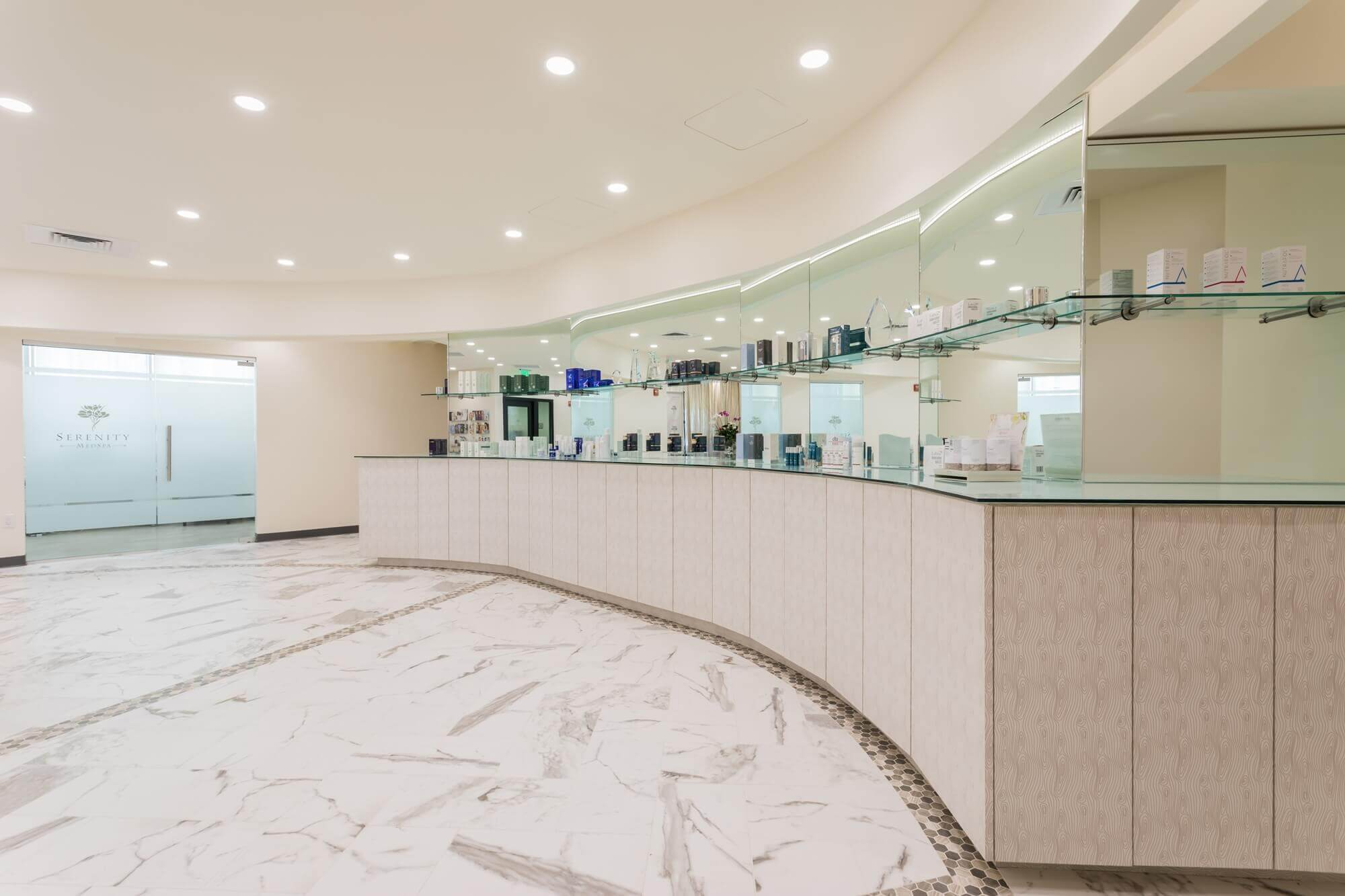 A large room in serinity medspa having white color ceiling