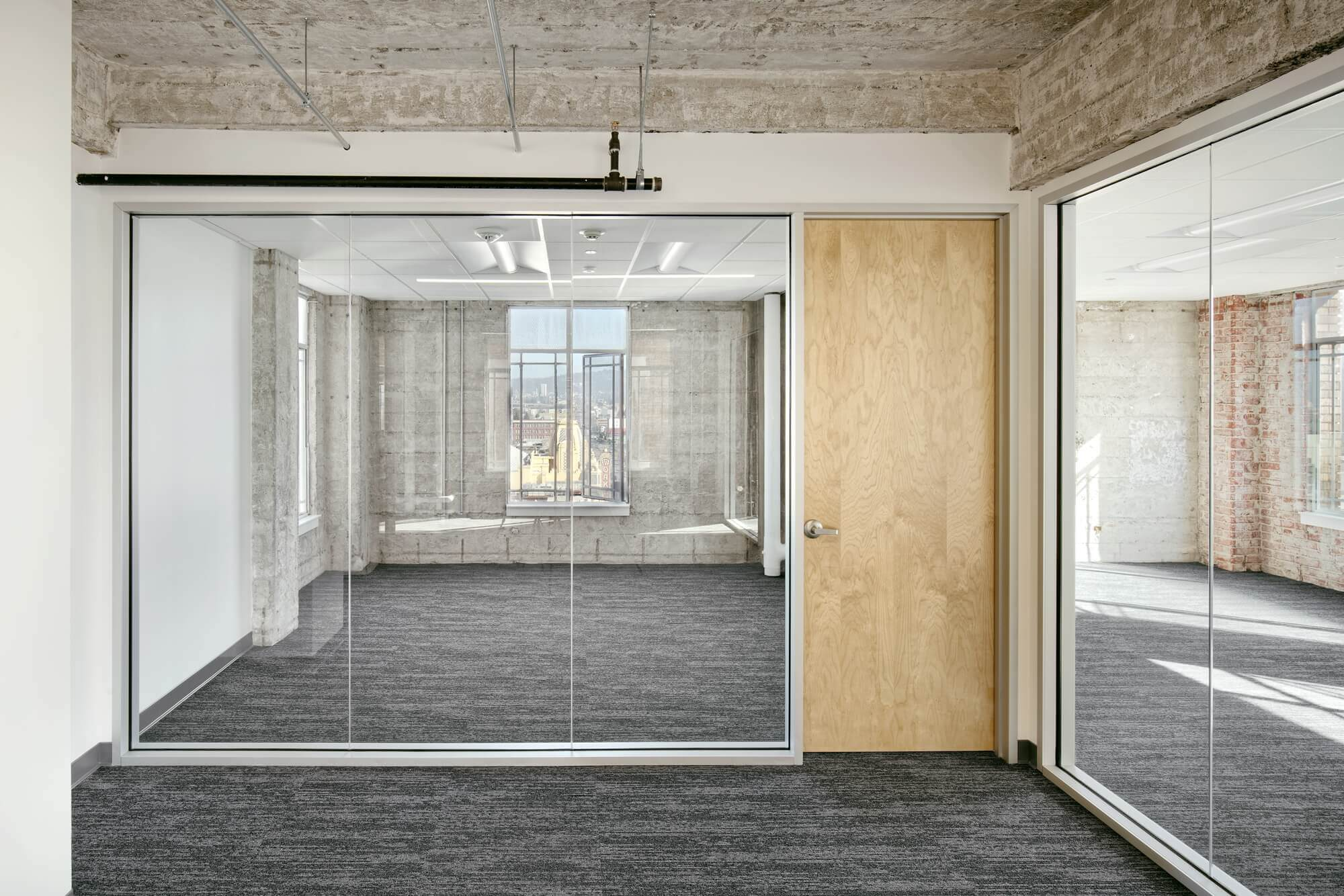 glass wall with wooden door - Commercial office renovation