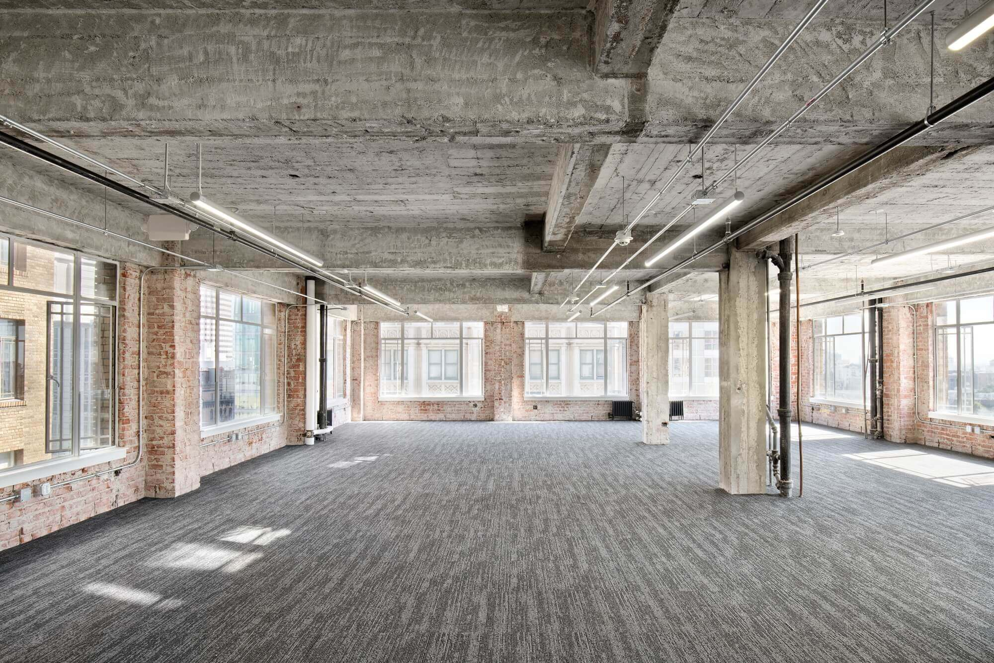 Large open office space construction build with large glass windows