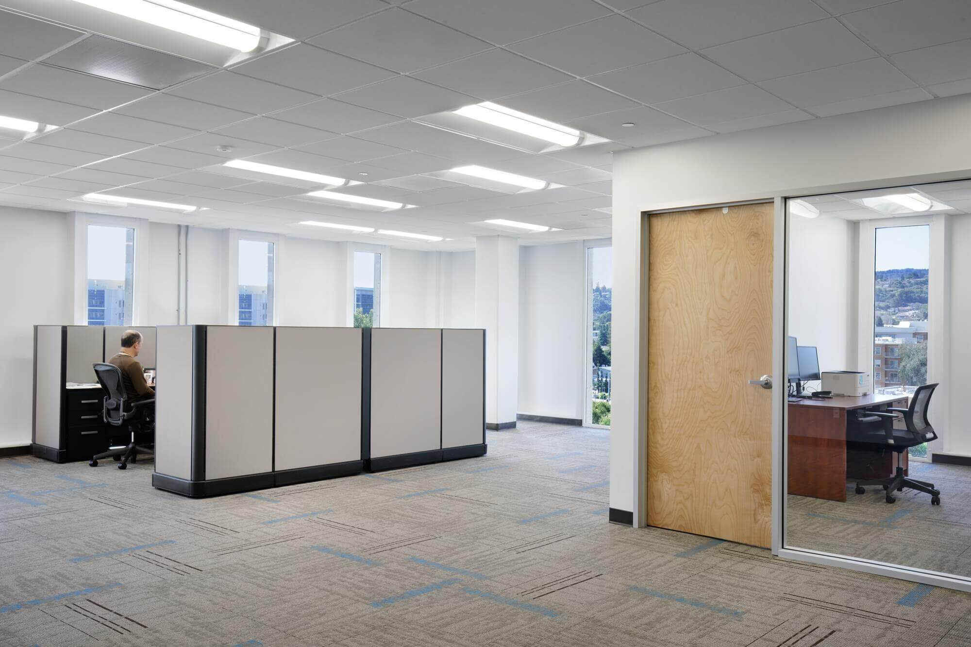 Respira Therapeutics open space office construction with wooden door and large glass window