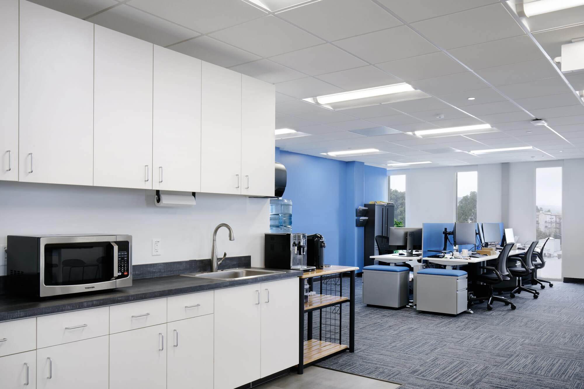 Pantry area with modular kitchen in open space office