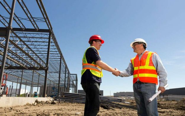 2 general contractors shaking hands at construction site in bay area san francisco