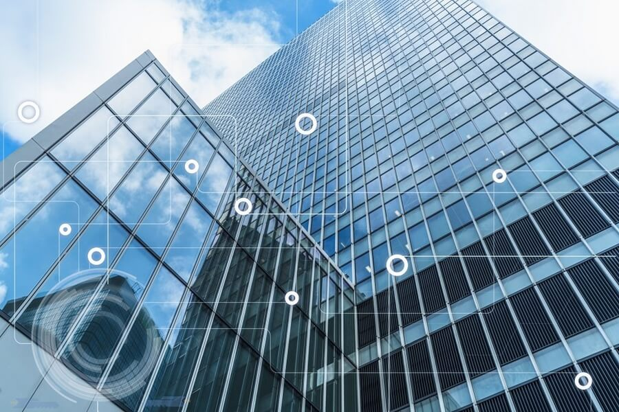 tall building in city with glass panels Intelligent Building Technology