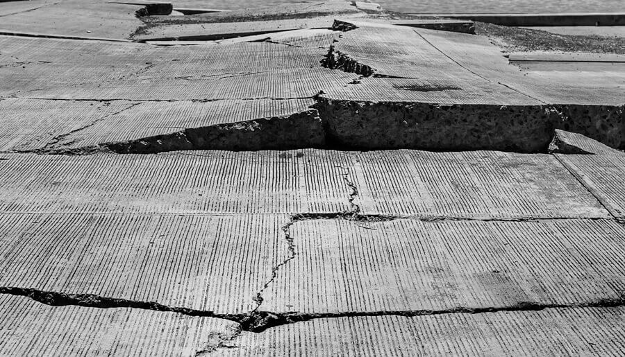 crack in concrete road because of earthquake
