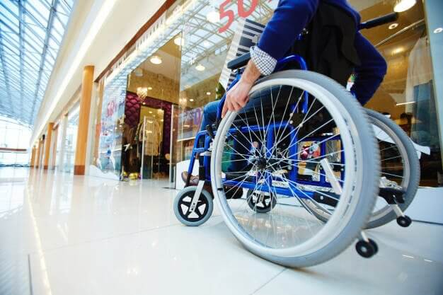 man on wheel chair in a shopping mall